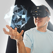 Teen uses virtual reality headset holding floating geometric image