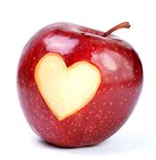 Apple with heart cut out of skin