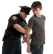 Police Officer handcuffing teen