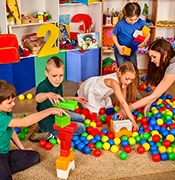 Group of K kids playing with balls and blocks