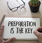 Preparation is the key written in a notebook