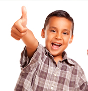Migrant kid thumbs up